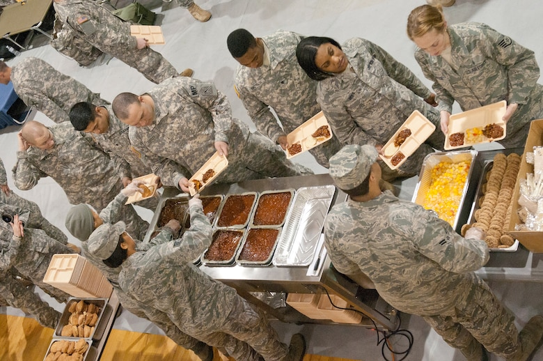Members of the Kentucky Air National Guard's 123rd Force Support Squadron serve hot meals to military police and security forces personnel Jan. 19, 2013, at McKinley Technology High School in Washington, D.C., in support of the 57th Presidential Inauguration. Nine members of the Kentucky unit deployed to provide food and lodging services to more than 300 troops. (Kentucky Air National Guard photo by Senior Airman Vicky Spesard)