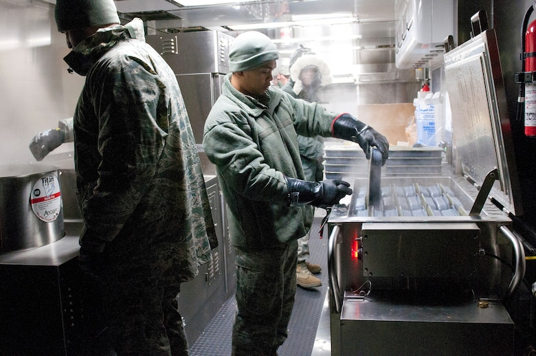 Members of the Kentucky Air National Guard's 123rd Force Support Squadron prepare meals for deployed Soldiers and Airmen at McKinley Technology High School in Washington, D.C., on Jan. 19, 2013. The Kentucky team served more than 1,800 meals from a Disaster Relief Mobile Kitchen Trailer. (Kentucky Air National Guard photo by Senior Airman Vicky Spesard)