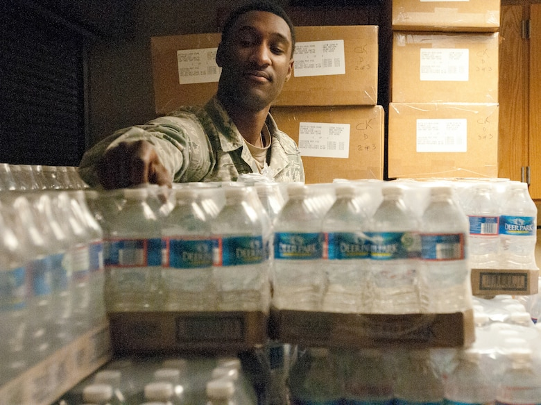 Senior Airman Dwight Trowell of the Kentucky Air National Guard's 123rd Force Support Squadron inventories water bottles Jan. 19, 2013, at McKinley Technology High School in Washington, D.C. Trowell was one of nine Kentucky Air Guardsmen who deployed to the nation's capital to provide food and lodging for National Guard members supporting the inauguration of President Barack Obama. (Kentucky Air National Guard photo by Senior Airman Vicky Spesard)