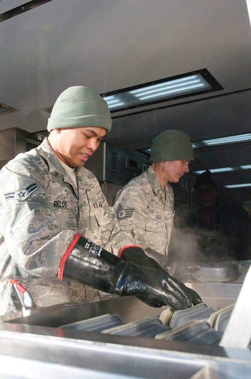 Members of the Kentucky Air National Guard's 123rd Force Support Squadron cook meals for deployed Soldiers and Airmen at McKinley Technology High School in Washington, D.C., on Jan. 19, 2013. The Kentucky team served more than 1,800 meals from a Disaster Relief Mobile Kitchen Trailer. (Kentucky Air National Guard photo by Senior Airman Vicky Spesard)