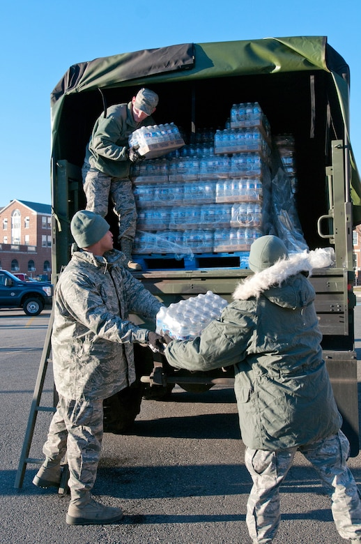 Members of the Kentucky Air National Guard's 123rd Force Support Squadron unload food and water at McKinley Technology High School in Washington, D.C., on Jan. 18, 2013. They were among nine Kentucky Air Guardsmen who deployed to the nation's capital to provide food and lodging for National Guard members supporting the inauguration of President Barack Obama. (Kentucky Air National Guard photo by Senior Airman Vicky Spesard)