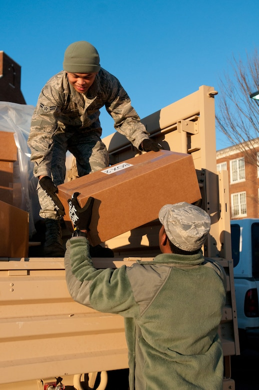 Airman 1st Class Reymart Relos of the Kentucky Air National Guard's 123rd Force Support Squadron in Louisville, Ky., unloads food and water at McKinley Technology High School in Washington, D.C., on Jan. 18, 2013. Relos was one of nine Kentucky Air Guardsmen who deployed to the nation's capital to provide food and lodging for National Guard members supporting the inauguration of President Barack Obama. (Kentucky Air National Guard photo by Senior Airman Vicky Spesard)