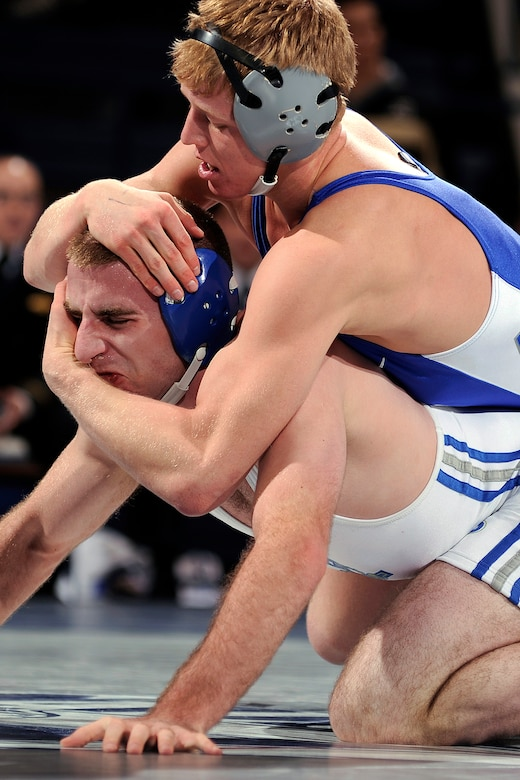 Cole VanOhlen (top) grapples with a wrestler from the U.S. Merchant Marine Academy during the All-Academy Championship Feb. 5, 2012. VanOhlen is one of the country's top wrestlers, with a 21-2 record and 12 falls -- an Air Force school record -- in the 2012-2013 season so far. (U.S. Air Force photo/Mike Kaplan)