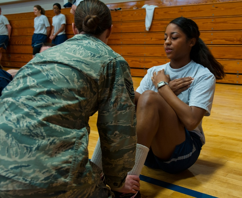 Airman Nicole Ferguson, 628th Logistics Readiness Squadron aircraft parts store apprentice, pushes herself to crunch out extra sit-ups during the Dorm Challenge Jan. 18, 2013, at Joint Base Charleston - Air Base, S.C. The quarterly Dorm Competition is a Wing initiative that is intended to encourage and incorporate all aspects of Comprehensive Airman Fitness, while also encouraging resident interaction and camaraderie. The Dorm Challenge consisted of push-ups, sit-ups and a game of dodgeball. (U.S. Air Force photo/Airman 1st Class Ashlee Galloway)
