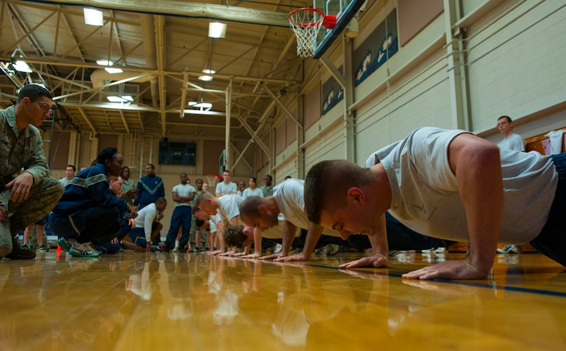 Airman Zachary Huffman, 628th Logistics Readiness Squadron fuels mobile equipment operator, squeezes out as many push-ups as he can during the Dorm Challenge Jan. 18, 2013, at Joint Base Charleston - Air Base, S.C. The quarterly Dorm Competition is a Wing initiative that is intended to encourage and incorporate all aspects of Comprehensive Airman Fitness, while also encouraging resident interaction and camaraderie. The Dorm Challenge consisted of push-ups, sit-ups and a game of dodgeball. (U.S. Air Force photo/Airman 1st Class Ashlee Galloway)