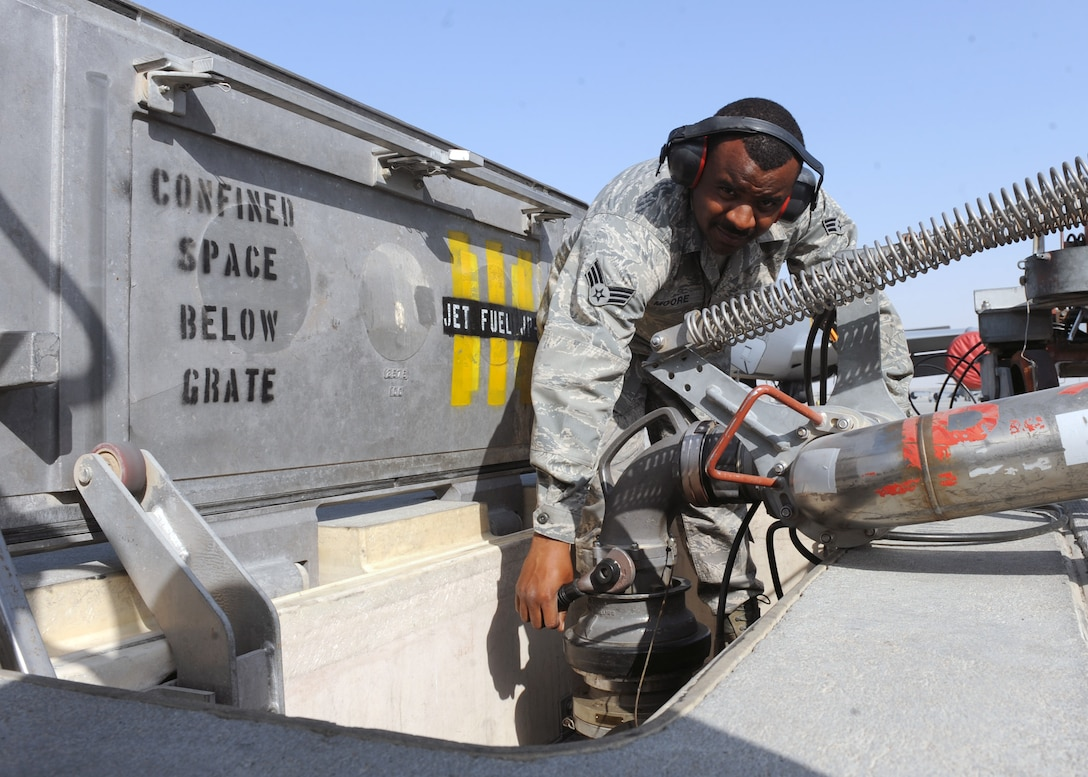 SOUTHWEST ASIA - Senior Airman Quincy Moore, 379th Expeditionary Logistics Readiness Squadron fuels distribution operator, opens the hydrant adapter in order to fill up his fuel truck on the flight line Jan. 22. Each truck can hold approximately 6,000 gallons of JP-8. Moore is deployed from Pope Field, N.C. (U.S. Air Force photo/Senior Airman Joel Mease)