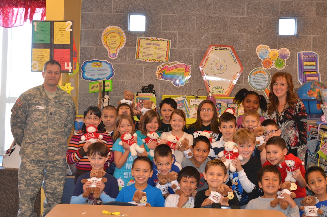 RIO RANCHO, N.M., -- On Jan. 13, Capt. John Deal  visited  Ms. Tracy Lewis' third grade class at 7 Bar Elementary School to deliver some gifts.