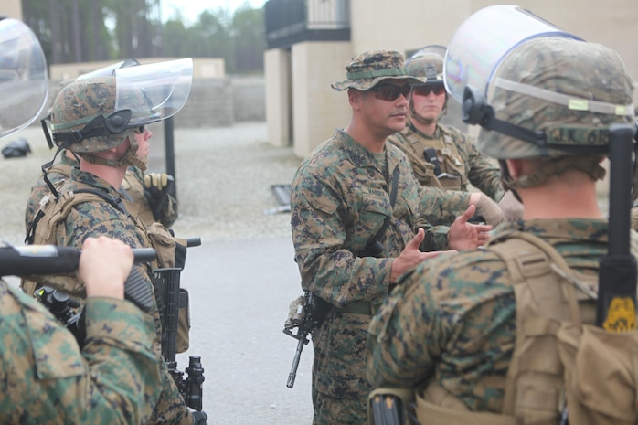 Gunnery Sgt. Jose Marquez(middle), the company gunnery sergeant, with Easy Company, Black Sea Rotational Force 13, instructs the Marines on what to do in certain violent and non-violent scenarios. Marines and sailors with Easy Company, and the 2013 iteration of BSRF conducted their first embassy reinforcement mission rehearsal exercise the week of January 7.