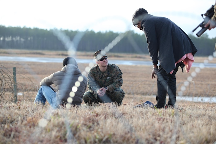 Petty Officer 3rd Class Andrew Sanders, a hospital corpsman with Black Sea Rotational Force 13, and an Elizabeth City, N.C., native, uses an interpreter to check the medical health of a detainee. Marines and sailors with the 2013 iteration of BSRF conducted their first noncombatant evacuation mission rehearsal exercise the week of January 7.