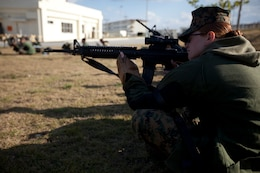 Sgt. Jody M. Roper sights in her M16A2 service rifle Jan. 18 during the first stages of the Far East Division Matches at Camp Schwab. During the matches, competitors will receive marksmanship instruction from some of the best marksmen in the Marine Corps, learn about the history of the Competition-In-Arms program, enhance their marksmanship abilities, and have a chance to complete their annual rifle and pistol qualifications while engaging in friendly competition. Roper is a shooter for the Marine Corps Base Butler team.