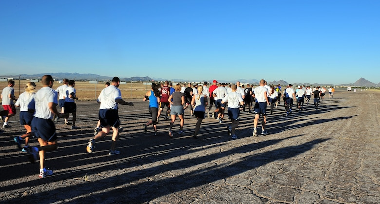 U.S. Air Force Airmen participate in a 5k run during a physical training session on Davis-Monthan Air Force Base, Ariz., Oct. 5,2012. (U.S. Air Force photo by Airman 1st Class Josh Slavin/Released)