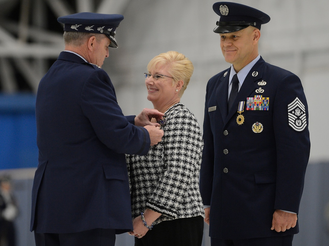 "Air Force Chief of Staff Gen. Mark A. Welsh III presents ""Miss Paula"" Roy, the wife of Chief Master Sgt. of the Air Force James Roy, with the Distinguished Public Service Medal during Chief Roy's retirement ceremony on Joint Base Andrews, Md. on Jan. 24, 2013. Roy, the 16th Chief Master Sgt. of the Air Force, is retiring after more than 30 years of service. (U.S. Air Force photo/Jim Varhegyi)"