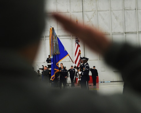 Col. Bill Knight, 11th Wing/Joint Base Andrews commander, salutes the colors during the Chief Master Sergeant of the Air Force Transition Ceremony on Joint Base Andrews, Md., Jan. 24, 2013. The 11th Wing hosted the event.(U.S. Air Force photo/ Airman 1st Class Nesha Humes)(Released)