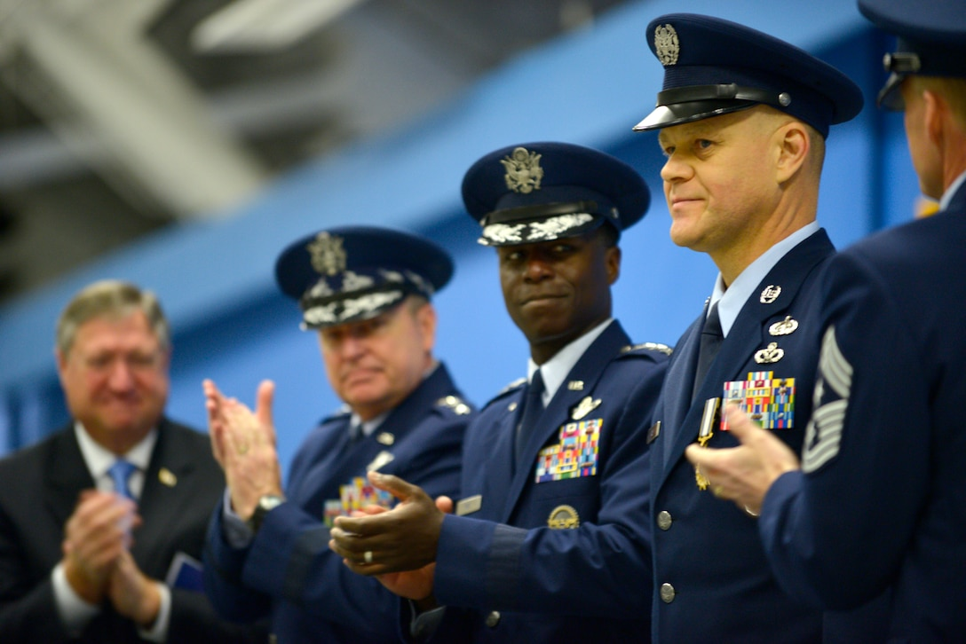 Secretary of the Air Force, Michael Donley, Air Force Chief of Staff Gen. Mark A. Welsh III, and Commander Air Education and Training Command Gen. Edward A. Rice Jr. congratulate Chief Master Sgt. of the Air Force James Roy as he retires after more than 30 years of service at Joint Base Andrews, Md., on Jan. 24, 2013. (U.S. Air Force photo/Master Sgt. Cecilio Ricardo)