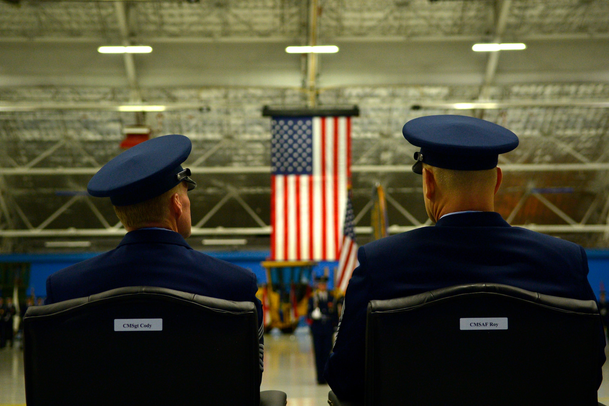 Chief Master Sgt. of the Air Force James Cody and the 16th Chief Master Sgt. of the Air Force (ret.) James Roy watch as the colors are posted during the retirement and transition ceremony at Joint Base Andrews, Md., Jan. 24, 2013. (U.S. Air Force photo/Master Sgt. Cecilio Ricardo)