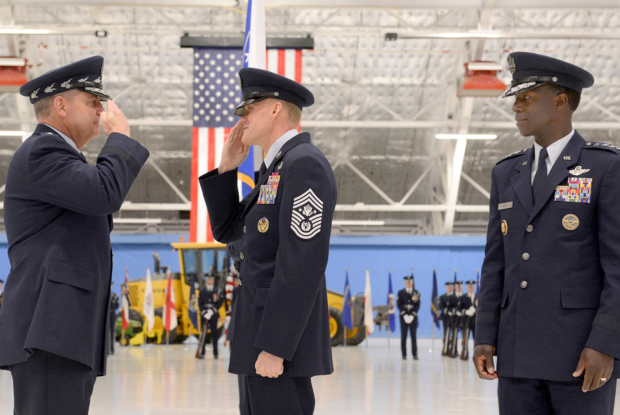 Air Force Chief of Staff Gen. Mark A. Welsh III, left, and Gen. Edward A. Rice Jr., the commander of Air Education and Training Command, congratulate the 17th Chief Master Sgt. of the Air Force James Cody during a transition ceremony at Joint Base Andrews, Md., on Jan. 24, 2013. (U.S. Air Force photo/Scott M. Ash)