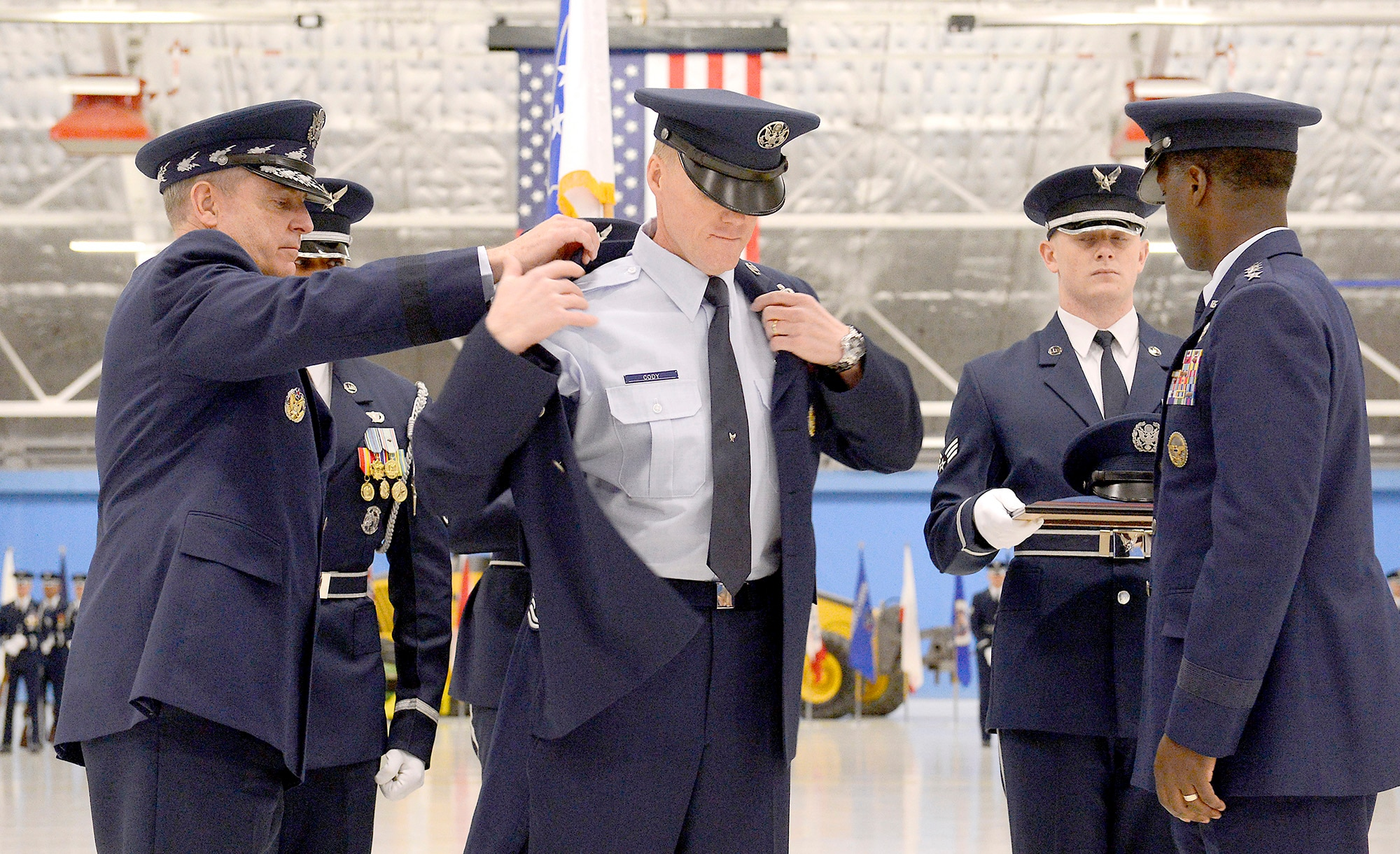 Becoming the 17th person to hold the office, Chief Master Sgt. James Cody receives his service dress coat with his new insignia from Air Force Chief of Staff Gen. Mark A. Welsh III and Gen. Edward A. Rice Jr., commander of Air Education and Training Command, at Joint Base Andrews, Md., on Jan 24, 2013. (U.S. Air Force photo/Scott M. Ash)