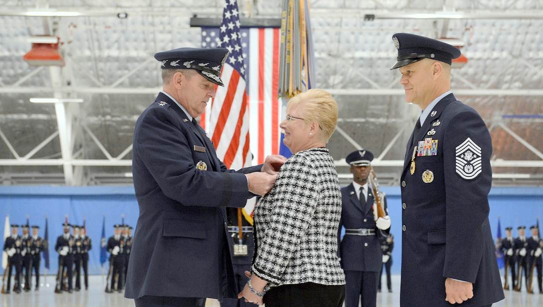 Air Force Chief of Staff Gen. Mark A. Welsh III presents Paula Roy, wife of  Chief Master Sgt. of the Air Force James Roy, the Distinguished Public Service award at Joint Base Andrews, Md., on Jan. 24, 2013, during Roy's retirement ceremony. (U.S. Air Force photo/Scott M. Ash)