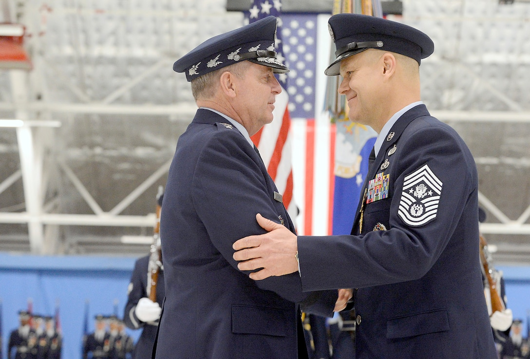 Air Force Chief of Staff Gen. Mark A. Welsh III congratulates Chief Master Sgt. of the Air Force James Roy at Joint Base Andrews, Md., on Jan. 24, 2013, during his retirement ceremony.   (U.S. Air Force photo/Scott M. Ash)