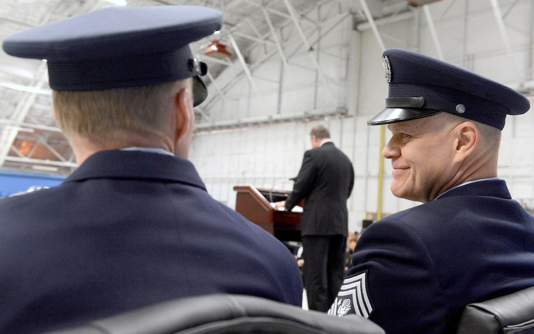 Chief Master Sgt. of the Air Force James Roy encourages his successor Chief Master Sgt. James Cody during their transition ceremony while Secretary of the Air Force Michael Donley congratulates them at Joint Base Andrews, Md., Jan. 24, 2013.   (U.S. Air Force photo/Scott M. Ash)