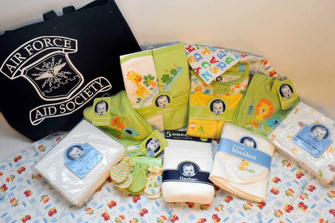 Every other month the Airman and Family Readiness Center provides parents an abundance of information and bundles of baby products to expecting families. The bundles include towels, clothing, baby blankets, bibs, bedding and a tote bag sponsored by the Air Force Aid Society. (U.S. Air Force photo by Airman 1st Class Riley Johnson/Released)