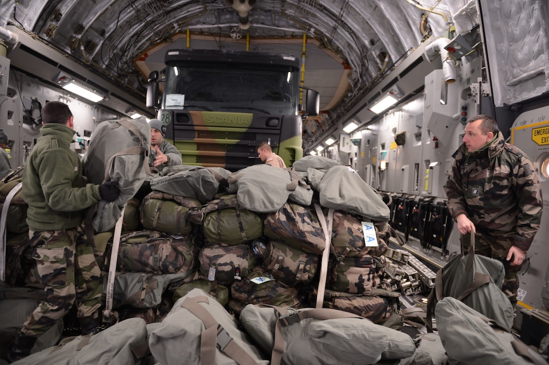 ISTRES, France -- Several French soldiers march to a U.S. Air Force C-17 Globemaster III here Jan. 20, 2013. The U.S. Air Force is transporting personnel to Mali in support of France's efforts to remove extremists who have taken control of the northern part of the country.  (U.S. Air Force photo by Senior Airman James Richardson) (Released)