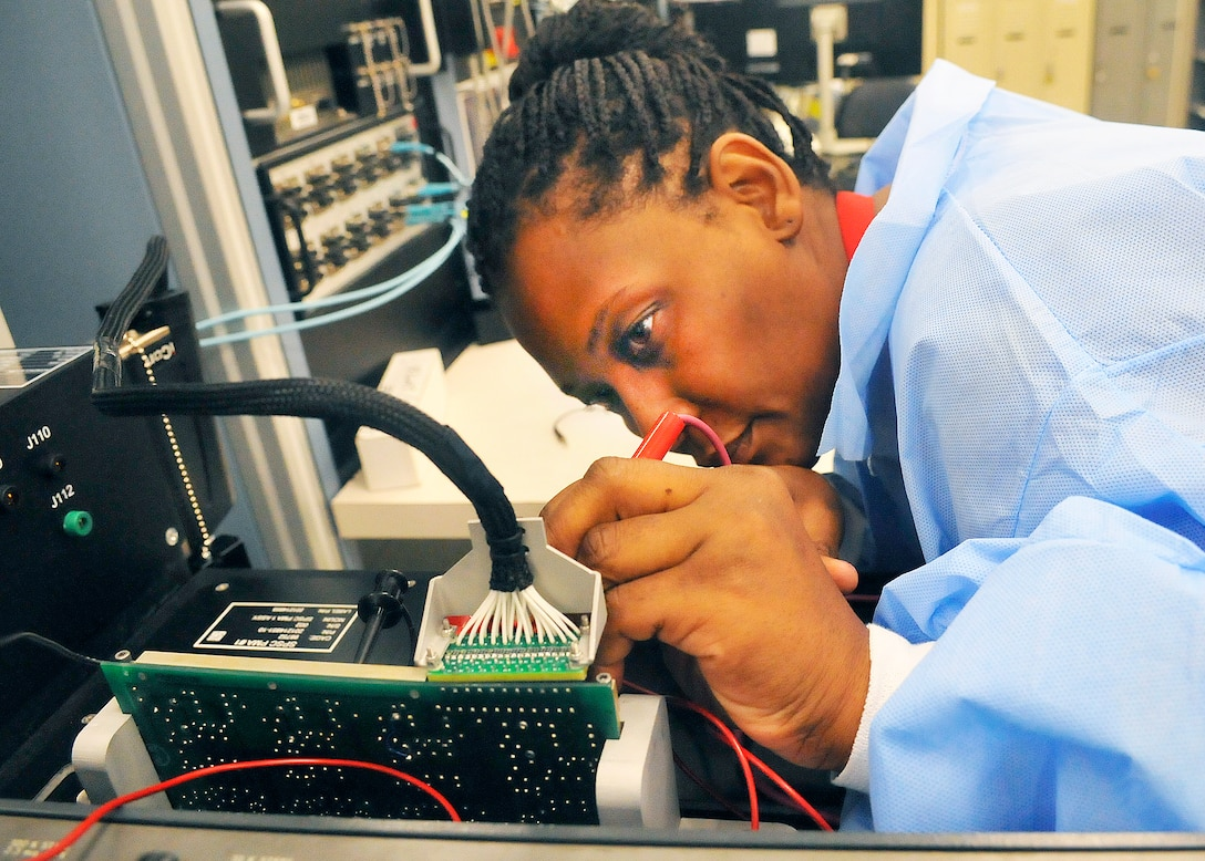 Jamie Loyd, electronics technician, probes a circuit card while running a diagnostic program. (U. S. Air Force photo/Sue Sapp)