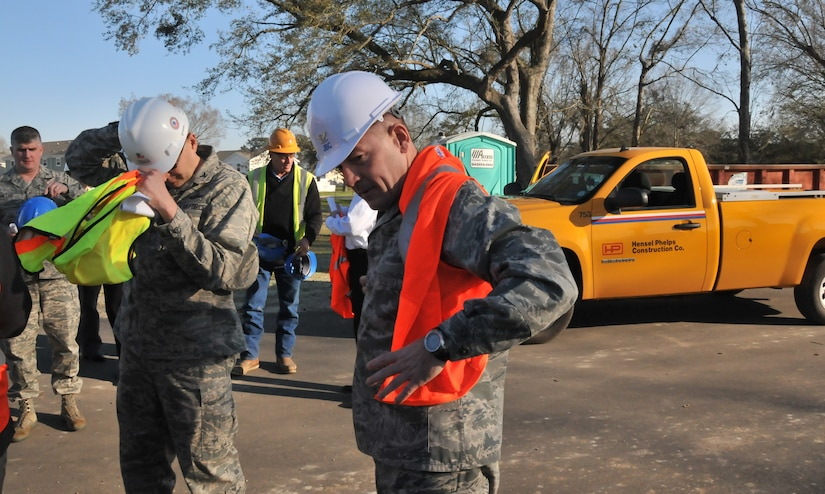 Col. Richard McComb, Joint Base Charleston commander, dons his protective equipment before touring the new community center, which is still under construction, Jan. 23, 2013 at JB Charleston – Air Base, S.C. Forest City, the privatized housing company at JB Charleston, recently completed phase four of the new housing development. Currently, 265 homes have been built and are available to military members and their families. (U.S. Air Force photo/ Airman 1st Class Jared Trimarchi)