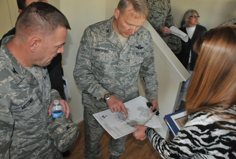 Col. Richard McComb, Joint Base Charleston commander, and Col. Darren Hartford, 437th  Airlift Wing commander,  view a map of the new Air Base housing community, Jan. 23, 2013 at JB Charleston – Air Base, S.C. Forest City, the privatized housing company at JB Charleston, recently completed Phase Four of the new housing development. Currently, 265 homes have been built and are available to military members and their families. (U.S. Air Force photo/ Airman 1st Class Jared Trimarchi)