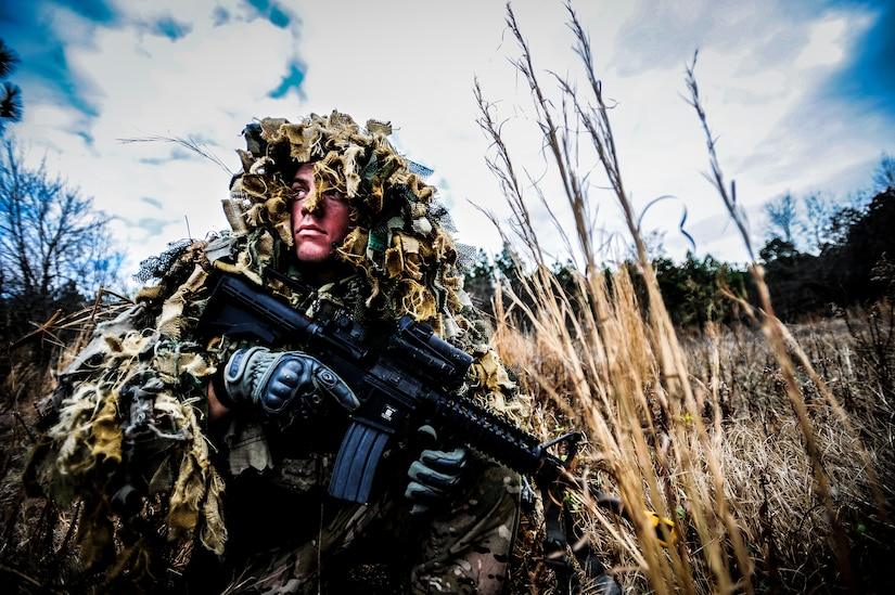 Staff Sgt. Samuel Weaver, 1st Combat Camera Squadron maintainer, waits in the grass for opposing forces role players, during the Ability to Survive and Operate exercise Jan. 16, 2013, at North Auxiliary Air Field, S.C. Combat Camera held the exercise to train Airmen to function outside the wire as combat documentation specialists. The week-long exercise began Jan. 7, 2013, and ended Jan. 18. The 1st CTCS acquires still and motion imagery in support of classified and unclassified air, sea and ground military operations. (U.S. Air Force photo/Senior Airman Dennis Sloan)