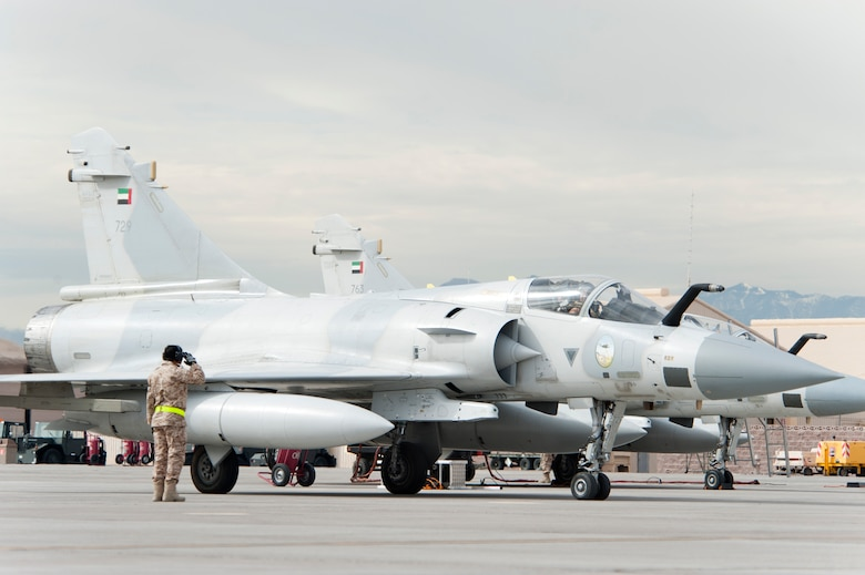 A United Arab Emirates Air Force crew chief salutes a Mirage 2000-9 pilot prior to take-off on the Nellis Air Force Base flight line Jan. 23, 2013. Six UAEAF's Mirage 2000-9 are participating in Red Flag 13-2 exercise. (U.S. Air Force photo by Lawrence Crespo)