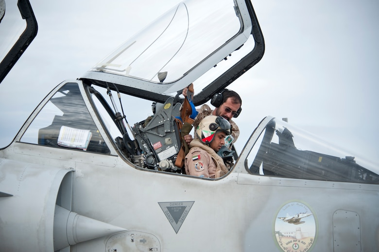 A United Arab Emirates Air Force crew chief secures a pilot's seat harness in a Mirage 2000-9 prior to a Red Flag 13-2 mission on the Nellis Air Force Base flight line Jan. 23, 2013. The Red Flag exercise provides allied air forces the opportunity to train air-to-air combat operations on the Nevada Test and Training Range north of Las Vegas. (U.S. Air Force photo by Lawrence Crespo)