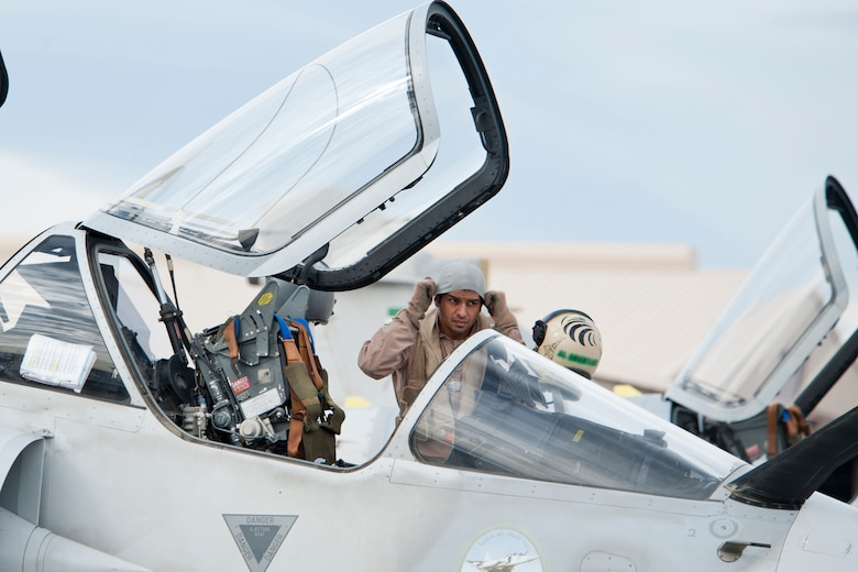 A United Arab Emirates Air Force pilot adjusts his head gear prior to entering a Mirage 2000-9 aircraft during Red Flag 13-2, on the Nellis Air Force Base flight line Jan. 23, 2013. Red Flag is a realistic combat training exercise involving the air forces of the United States and its allies. (U.S. Air Force photo by Lawrence Crespo)