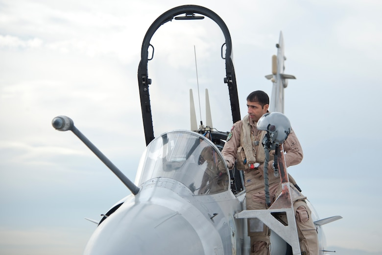 A United Arab Emirates Air Force pilot enters his Mirage 2000-9 aircraft on the Nellis Air Force Base flight line Jan. 23, 2013. Six UAEAF aircraft will train joint air-to-air tactics on the Nevada Test and Training Range north of Las Vegas during Red Flag 13-2. (U.S. Air Force photo by Lawrence Crespo)