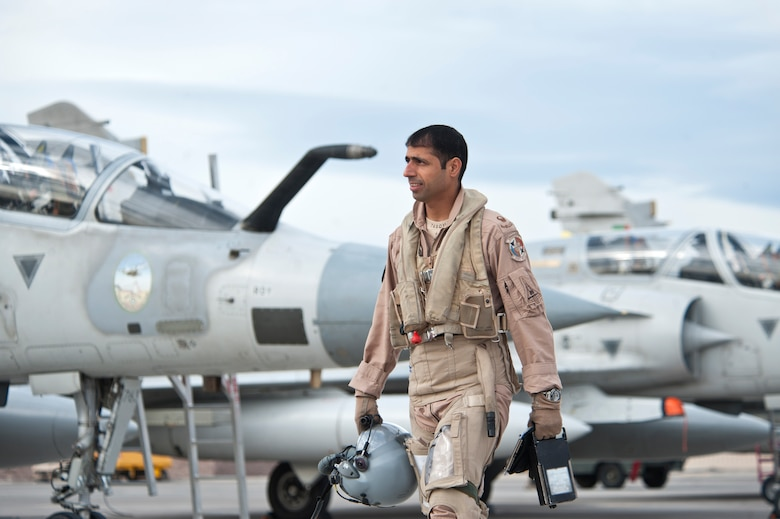 A United Arab Emirates Air Force pilot walks to his Mirage 2000-9 on the Nellis Air Force Base flight line Jan. 23, 2013. More than 160 UAEAF pilots, maintainer and support people are participating in Red and Green Flag exercises. (U.S. Air Force photo by Lawrence Crespo)