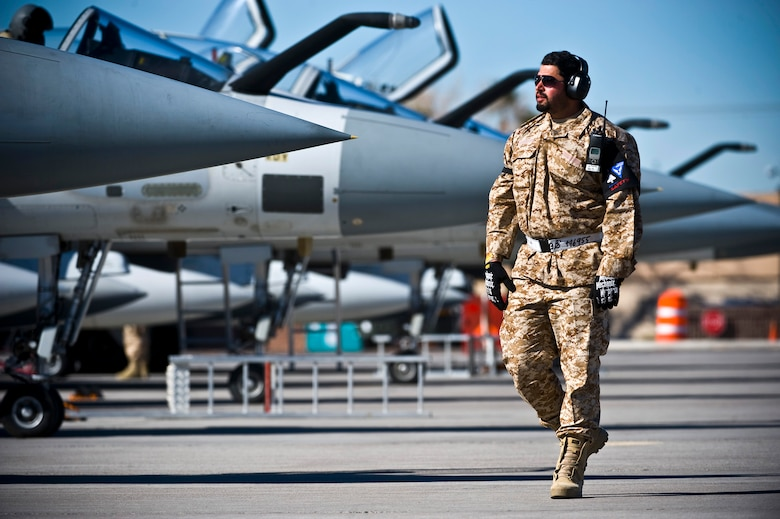 United Arab Emirates Air Force Warrant Officer Abdulrhamn Alali, crew chief, observes UAE Mirage 2000-9 pilots conducting pre-flight checks during Red Flag 13-2, Jan. 22, 2013, at Nellis Air Force Base, Nev. UAE's participation in the U.S. Air Force's Red Flag exercise builds international air force cooperation, inter-operability and mutual support. (U.S. Air Force photo/Senior Airman Brett Clashman)