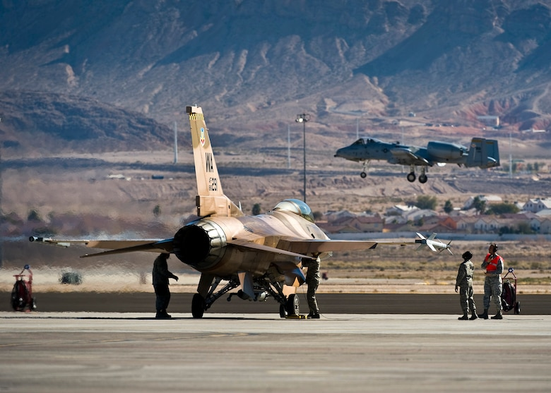 U.S. Air Force Airmen conduct pre-flight checks on a 64th Aggressor Squadron F-16 Fighting Falcon during Red Flag 13-2, Jan. 22, 2013, at Nellis Air Force Base, Nev. The 64 AGRS's mission is to prepare the combat air forces, joint and allied aircrews for tomorrow's victories with challenging and realistic threat replication, training, academics and feedback. (U.S. Air Force photo/Senior Airman Brett Clashman)