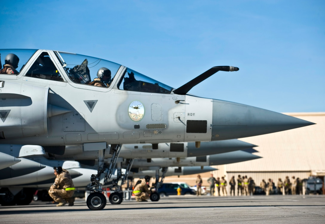 Members of the United Arab Emirates Air Force conduct pre-flight checks on Mirage 2000-9 aircraft during Red Flag 13-2, Jan. 22, 2013, at Nellis Air Force Base, Nev. This is the first appearance for the Mirage 2000-9 in a Red Flag exercise. (U.S. Air Force photo/Senior Airman Brett Clashman)