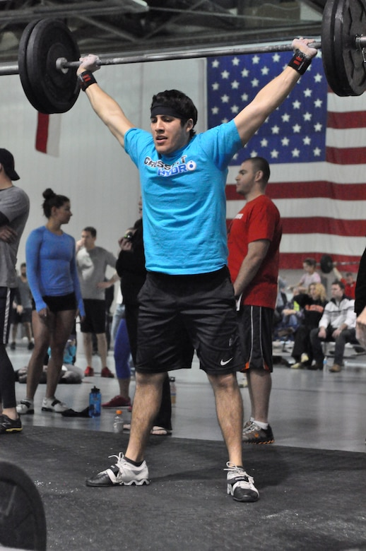 CrossFit Hydro's Jose Palacios overhead squats 95 pounds during heat three of the second workout. (U.S. Air Force Photo by 2nd Lt. Carly Costello/Released)