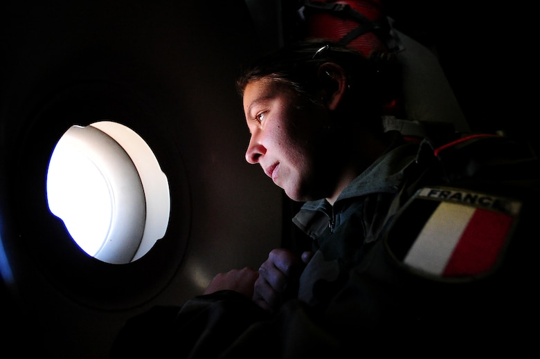 WESTERN EUROPE - French soldier, Marjorie Moreaux, looks out of a window while in route to Mali in a U.S. Air Force C-17 Globemaster III. The United States has agreed to help France airlift troops and equipment into Mali. (U.S. Air Force photo by Senior Airman James Richardson/Released)