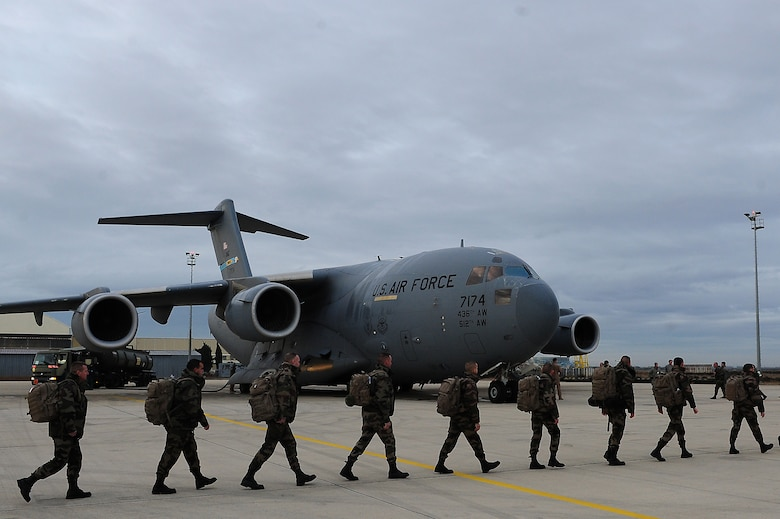 ISTRES, France - French soldiers march to a U.S. Air Force C-17 Globemaster III in support of missions in the Republic of Mali. The United States has agreed to help France airlift troops and equipment into Mali. (U.S. Air Force photo by Senior Airman James Richardson/Released)