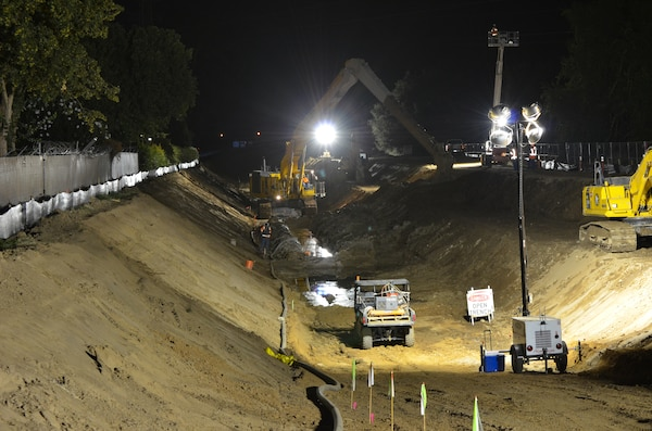 Construction crews work in darkness--when energy demand is lowest--on a stretch of American River levee near the California State University-Sacramento campus Sept. 12, 2012 to close a 900-foot-long gap in a seepage cutoff wall underneath high power lines. 