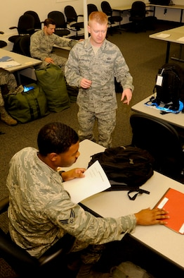 VANDENBERG AIR FORCE BASE, Calif. – Tech. Sgt. Erik Snyder, a 30th Comptroller Squadron quality assurance manager, conducts a bag-drag in preparation for a unit compliance exercise deployment here Friday, Jan. 25, 2013. A mobility bag consists of items essential for an Airman to have when tasked to deploy at a moments notice. (U.S. Air Force photo/Airman Yvonne Morales)