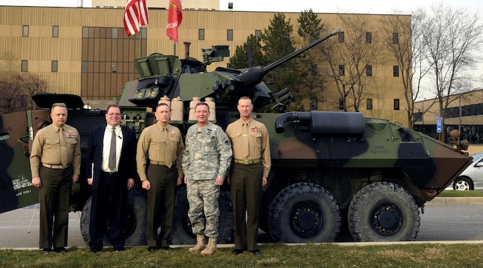 Brigadier General Frank Kelley, Commander, Marine Corps Systems Command (center) visited Light Armored Vehicle and Robotic Systems sites Jan. 15 in Warren, Mich. Also pictured from left are Colonel Mark Brinkman, Program Manager LAV; Michael Viggato, Deputy to the Commander, U.S. Army TACOM Life Cycle Management Command; Army Major General Michael Terry, Commanding General, USATACOM LCMC; and Chief Warrant Officer 5 James Steiner, PM LAV. (PM LAV photo)