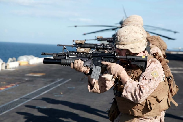 Marines with Kilo Company, Battalion Landing Team 3/5, 15th Marine Expeditionary Unit, fire at their targets on the flight deck of the USS Peleliu, Jan. 22. Kilo Company is one of three rifle companies in BLT 3/5, the 15th MEU's ground combat element. The 15th MEU is deployed as part of the Peleliu Amphibious Ready Group as a U.S. Central Command theater reserve force, providing support for maritime security operations and theater security cooperation efforts in the U.S. 5th Fleet area of responsibility. (U.S. Marine Corps photo by Cpl. John Robbart III)