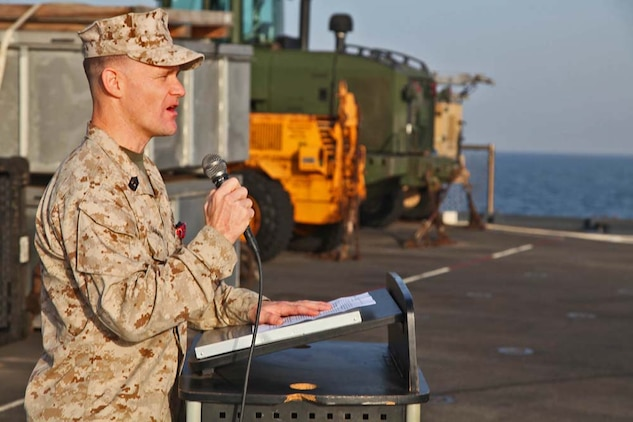 First Sgt. Bradley G. Simmons, Sergeant Major, Combat Logistics Battalion 15, 15th Marine Expeditionary Unit, speaks to the Marines and sailors of CLB-15 after being presented the Bronze Star with Combat Distinguishing Device, aboard the USS Rushmore, Jan. 25. Simmons, 34, is a native of Liberal, KS. The 15th MEU is deployed as part of the Peleliu Amphibious Ready Group as a U.S. Central Command theater reserve force, providing support for maritime security operations and theater security cooperation efforts in the U.S. 5th Fleet area of responsibility. (U.S. Marine Corps photo by Cpl. Timothy R. Childers)
