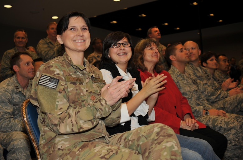 Major Sandra Pertuit (pictured left) is among the returning airmen and their families honored at the Welcome Home Airmen ceremony, Jan. 24.  The airmen returned during the past six months from deployments at locations around the world.  (Photo by Sarah Corrice)