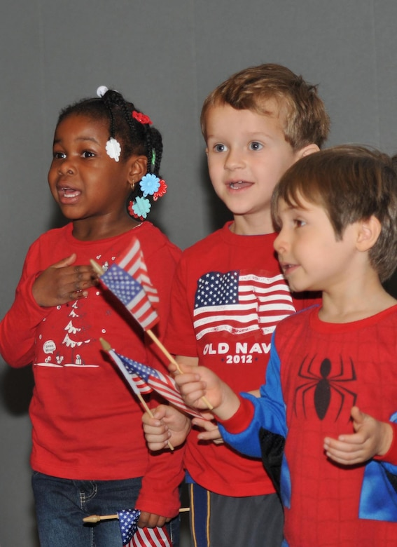 Children from the Los Angeles AFB Child Development Center sing the National Anthem during the Welcome Home Airmen ceremony, Jan. 24.  (Photo by Sarah Corrice)