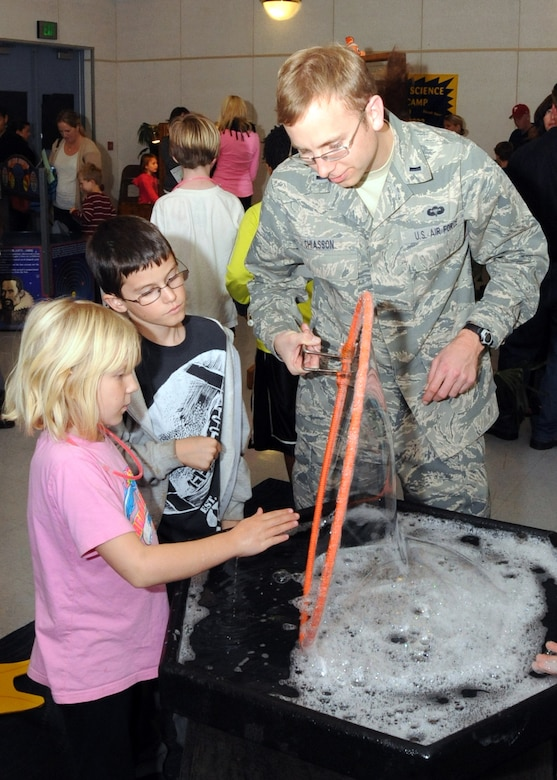 Lt. Thomas Chiasson works with students at a Science, Technology, Engineering and Mathematics (STEM) event held at El Segundo's Richmond Street School, Jan. 23. Air Force volunteers manned various experiment stations during the event.  (Photo by Jim Gordon)