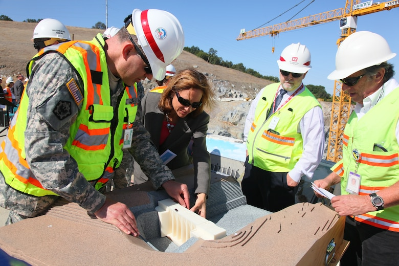 Sacramento District commander Col. Bill Leady shows off a 1/240-scale model of the Folsom Dam auxiliary spillway in Folsom, Calif., during a site visit in May 2012. The Corps uses models created with a 3-D printer to help show team members, community leaders and the public how projects will look and operate.